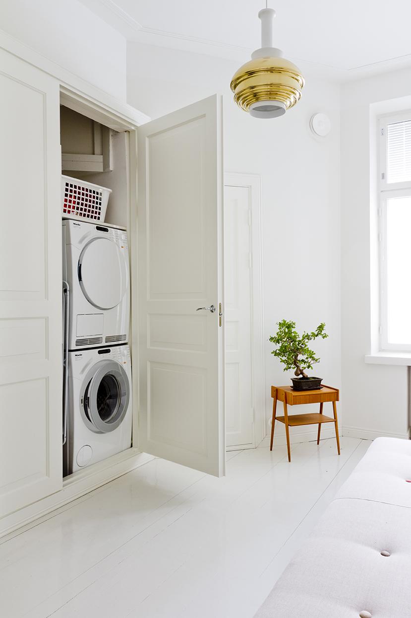 pesutorni piilottettuna kaappiin vierashuone kodinhoitohuone